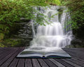 Waterfall Flowing Over Rocks In Pages Of Book Royalty Free Stock Photos - 20155068