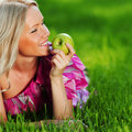 Blonde On Green Grass Royalty Free Stock Photos - 20155978