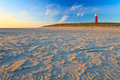 Seaside With Sand Dunes And Lighthouse At Sunset Stock Photo - 20261960