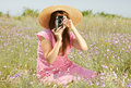 Retro Style Girl At Countryside With Camera Royalty Free Stock Photography - 20276557