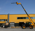 Elevating Crane Near A Warehouse Royalty Free Stock Images - 20313359