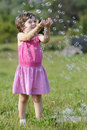 Happy Girl Catching Balloons Stock Photography - 20322882