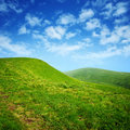 Green Hills And Blue Sky With Clouds Royalty Free Stock Photography - 20323797