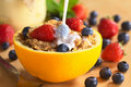 Pouring Milk Over Cereal With Fruits Royalty Free Stock Photography - 20358457