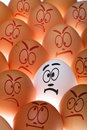 White Egg Between Brown Ones Stock Photo - 20366170