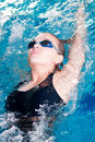 Swimmer In Swim Meet Doing Backstroke Stock Photo - 20453610