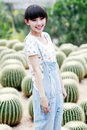 Young Asia Girl In Cactus Field. Royalty Free Stock Images - 20467679