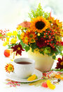Up Of Tea And Autumnal Flowers Royalty Free Stock Photography - 20550447