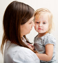A Mother Is Holding A Sick Girl. Royalty Free Stock Photo - 20567345
