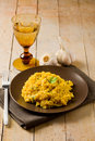 Risotto With Saffron On Wooden Table Royalty Free Stock Images - 20571279