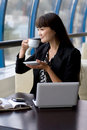 Businesswoman Having A Cup Of Tea Royalty Free Stock Image - 20578076