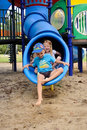 Young Kids Exiting A Tube Slide Royalty Free Stock Photos - 20681828