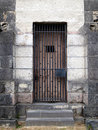 Old Stone Jail Wooden Door With Iron Bars Royalty Free Stock Images - 20706999