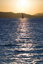 Sailboat Bathed In Dawn Sunlight Stock Photography - 20708692