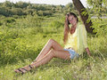 A Beautiful Girl Sitting On Grass Royalty Free Stock Images - 20714969