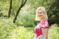 Adorable Blond Woman Walks In The Summer Forest Stock Photo - 20720050