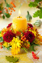Wreath Of Autumn Flowers And Candle Stock Photo - 20723490