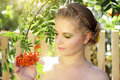 Girl With Ashberries Royalty Free Stock Image - 20767336