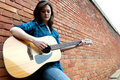 Young Woman Playing Guitar Stock Image - 20816031