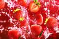 Strawberry Falling Into The Lot Of Juice Royalty Free Stock Photos - 20826308