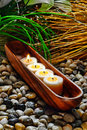 Candles Burning In Wood Vessel In A Holistic Spa Stock Photos - 20877883