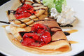 Two Crepes With Strawberries And Ice Cream Royalty Free Stock Images - 20897429