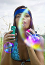 Woman Blowing Soap Bubble Royalty Free Stock Photos - 20900758