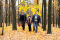 Family In Autumn Forest Stock Image - 20921521