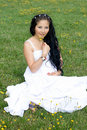 Beautiful Pregnant Girl Sitting On Grass Stock Image - 20927451