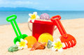 Spade And Other Toys On Tropical Beach Royalty Free Stock Images - 20943089