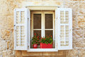 Old Shutter Windows With A Flowers. Croatia. Royalty Free Stock Photo - 21022415