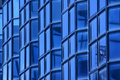 Blue Glass Wall Of Building Royalty Free Stock Photos - 21028408