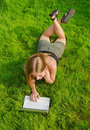 Girl With Laptop Lying On Lawn Stock Photo - 21059590