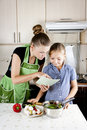 Woman With A Daughter In The Kitchen Preparing Stock Photography - 21102222