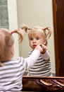Girl And Mirror Royalty Free Stock Image - 21167426