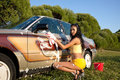 Sexy Girl Washing A Car - Pin-up Style Royalty Free Stock Photo - 21195165