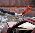 Hooligan Smashing Windshield Stock Photography - 21212082