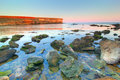 Sea Landscape At Sunset With Stones Royalty Free Stock Images - 21242299