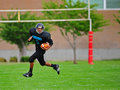 Youth American Football Running Back Going For It Royalty Free Stock Photography - 21257407