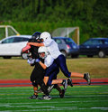 Youth American Football The Take Down Stock Image - 21258161