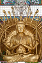 Golden Kuan Yin Statue In Temple Royalty Free Stock Image - 21272926