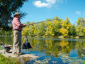 Senior Fisherman Catches A Fish Stock Images - 21344044