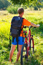 Man Cyclist With Bike And Backpack Stock Photo - 21395450
