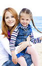 Two Sisters At The Beach In Sunny Autumn Day Royalty Free Stock Photography - 21400887