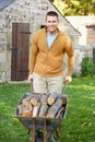 Man Working In Country Garden Stock Image - 21408341