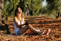 Girl With A Laptop In A Field In Autumn Royalty Free Stock Image - 21511746