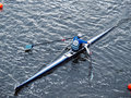 Man Rowing In Boat On Water Stock Images - 21545034