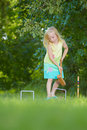 Young Girl Playing Croquet Royalty Free Stock Image - 21561016