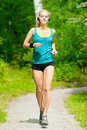 Beautiful Young Woman Running On Music Royalty Free Stock Image - 21561766