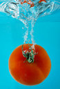 Tomato In Clear Water Royalty Free Stock Photo - 2169775